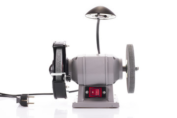 Bench grinder with lamp isolated on white