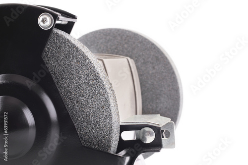 Closeup of bench grinder isolated on white
