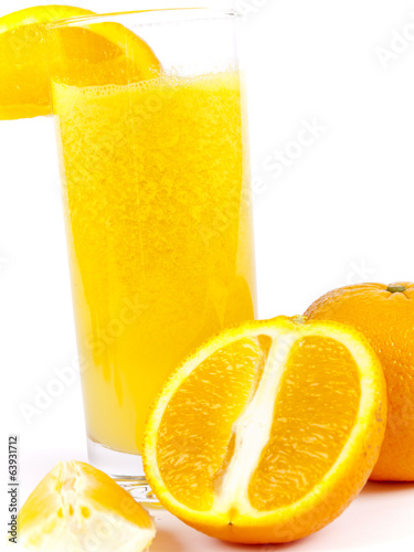Freshly squeezed orange juice and cut orange