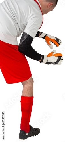 Goalkeeper in red and white ready to catch
