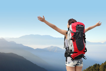 happy woman mountain hiker