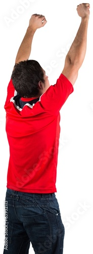 Excited football fan in red cheering