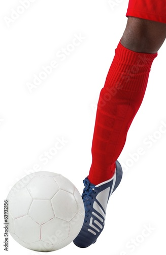 Football player kicking ball with boot