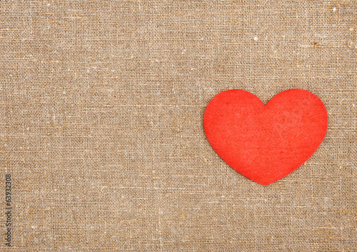 Felt red heart on the burlap