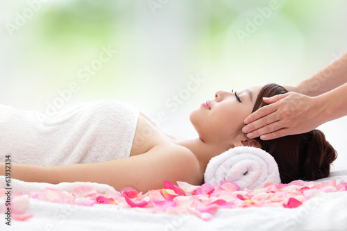 beautiful woman receiving massage