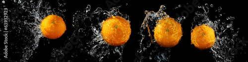 Set of fresh oranges in water splash - 63932923