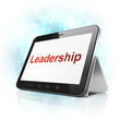 Finance concept: Leadership on tablet pc computer