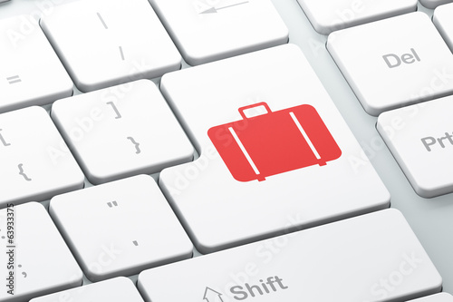 Tourism concept: Bag on computer keyboard background