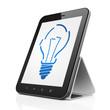 Finance concept: Light Bulb on tablet pc computer