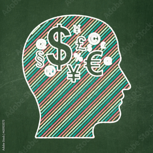 Finance concept: Head With Finance Symbol on chalkboard