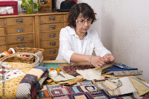 Mature woman by sewing and quilting