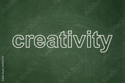 Advertising concept: Creativity on chalkboard background