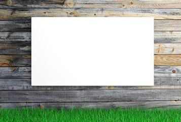 White blank canvas with grass on wooden background