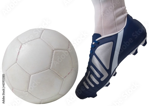 Close up of football player kicking ball