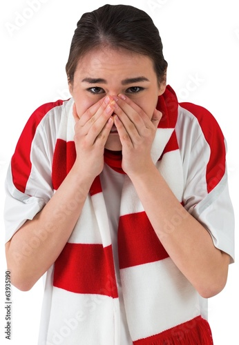 Nervous football fan looking ahead