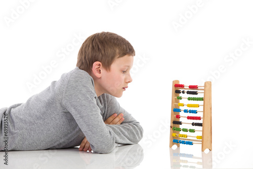 Thinking schoolboy and abacus