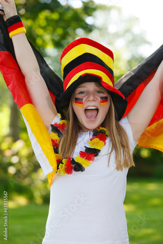 german soccer fan waving her flag
