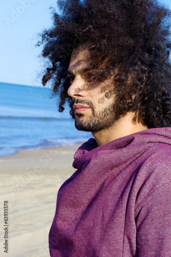 Profile of good looking italian man looking the ocean