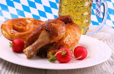 Oktoberfest chicken and radish, pretzel, beer