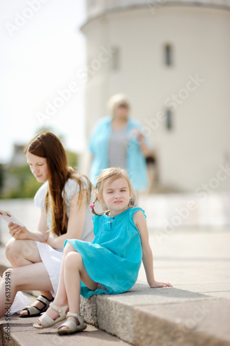 Adorable little girl eating ice cream