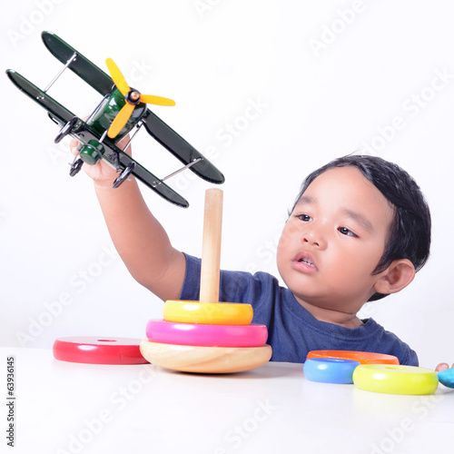 Kid playing toys