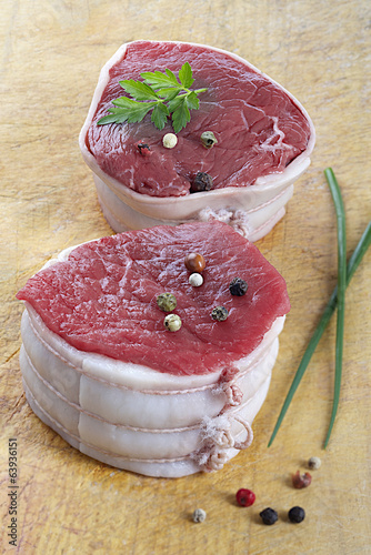 2 Juicy thick center cut tournedos beef,on wood plate