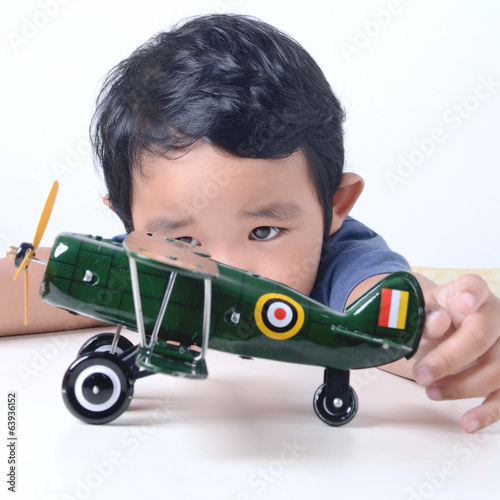 Kid playing with toy aeroplane