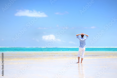 Young man enjoying a sea view