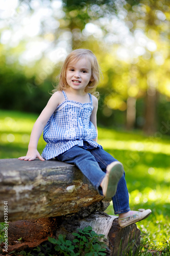 Adorable little girl outdoors