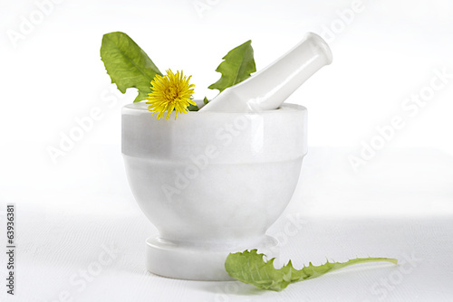 dandelion and flowers in ceramic mortar