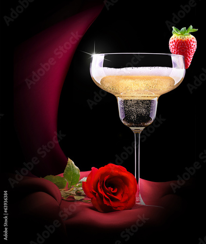 champagne glass on black and red silk