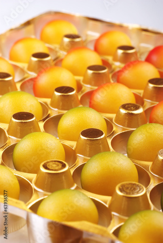 Marzipan eggs in plastic blister.