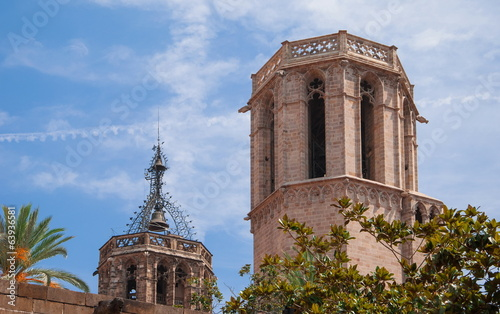 Old cathedral with  bell tower in historic part of Barcelona