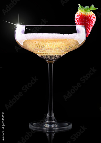 glass of champagne with tasty strawberry