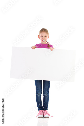 Smilling little girl posing with blank banner.