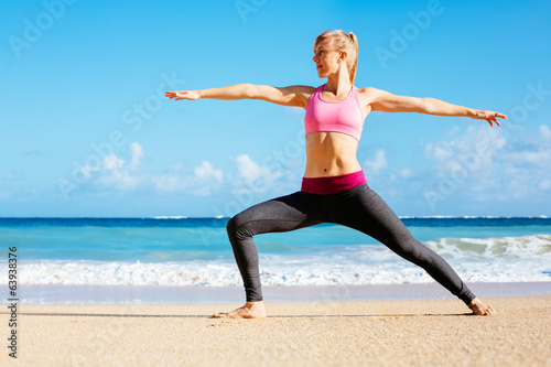 Athletic Fitness Woman Running on the Beach - 63938376