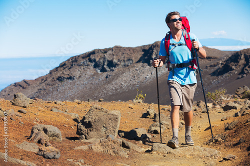 Hiker enjoying walk on amazing mountain trail