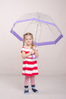 Girl in dress with umbrella