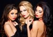 Trio of elegant beautiful coquettish women