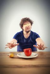 Blindfolded man wants to taste vegetables
