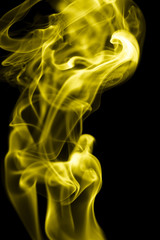 yellow smoke on a black background