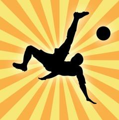 Silhouette of football player man kicking ball