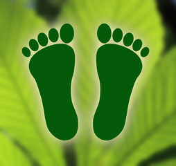 Symbol of ecological footprint on green