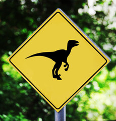 Yellow traffic label with dinosaur pictogram