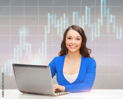 smiling woman in blue clothes with laptop computer