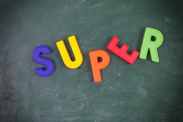 Super. Written on a blackboard.