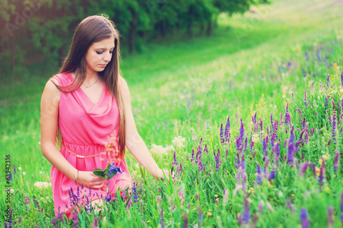 Gorgeous girl picking flowers