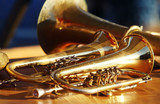 Fototapety Blowing brass wind instrument on table