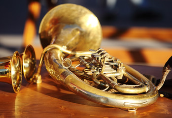 Blowing brass instrument on table