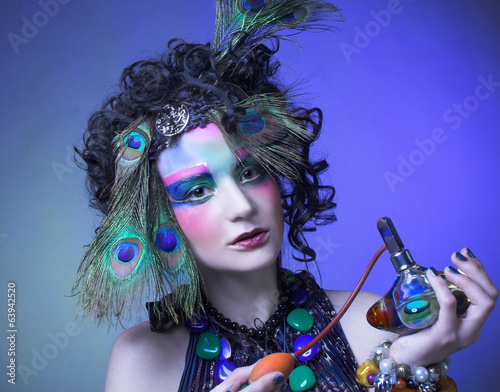 Woman in peacock image.